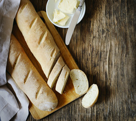 Fresh homemade bread and butter on wooden table