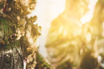 Gilding leaf on  buddha statue, religion belives