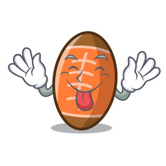 Tongue out rugby ball mascot cartoon