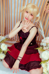blonde in a black and red dress