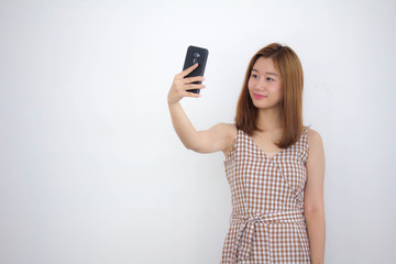 Portrait of thai china adult beautiful girl using her smart phone Selfie