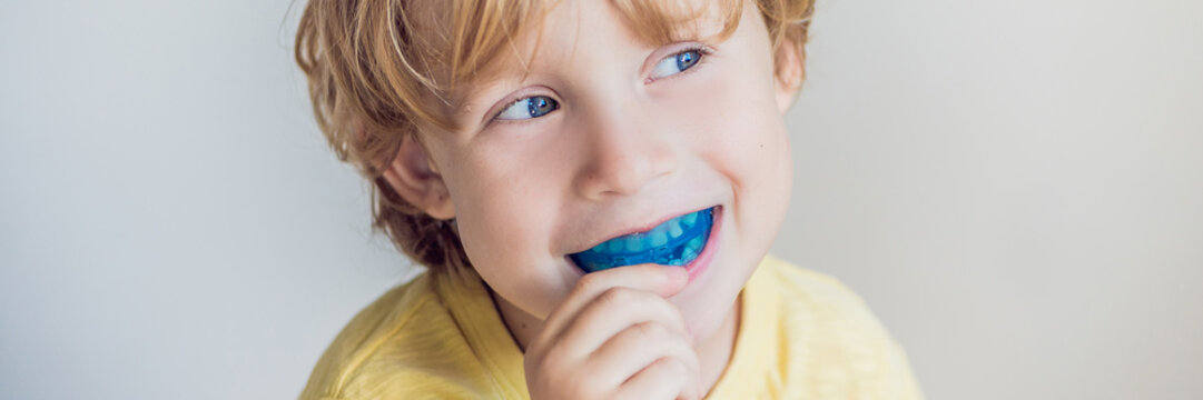 Three-year old boy shows myofunctional trainer to illuminate mouth breathing habit. Helps equalize the growing teeth and correct bite. Corrects the position of the tongue BANNER, long format