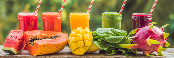 Rainbow from smoothies. Watermelon, papaya, mango, spinach and dragon fruit. Smoothies, juices, beverages, drinks variety with fresh fruits on a wooden table BANNER, long format