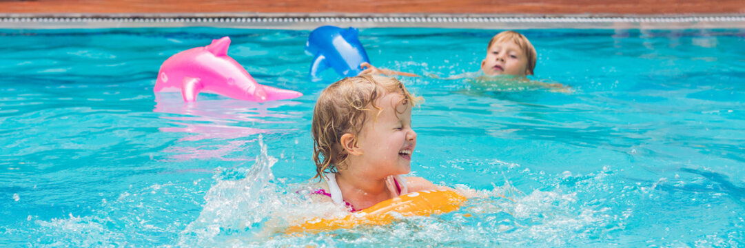 Pretty little girl swimming in outdoor pool and have a fun with inflatable circle BANNER, long format