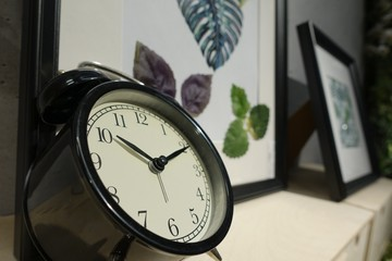 Interior design decoration concept of clock black color on wall, business times working in office and house