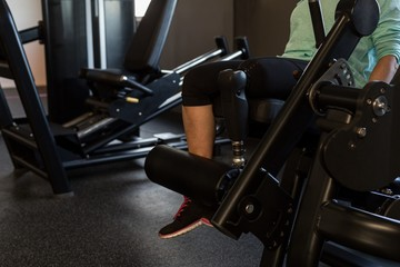 Woman exercising on machine in the gym