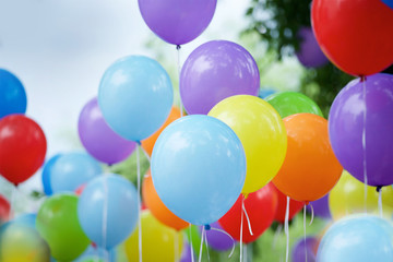 Balloons of different colors filled with helium