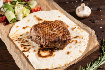 grilled steak with sauce