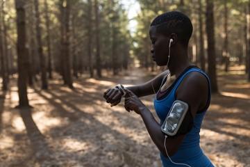 Female athlete checking her smartwatch