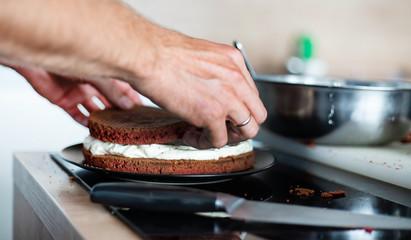 chef making red velvet cake