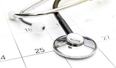 Stethoscope on calendar. Medical appointment concept.