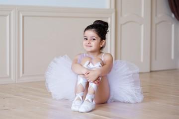 Little girl ballerina in white tutu