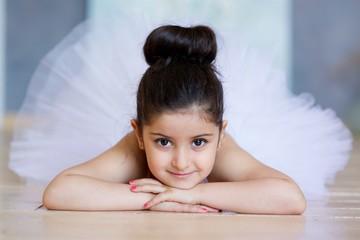 Little girl ballerina in a white tutu