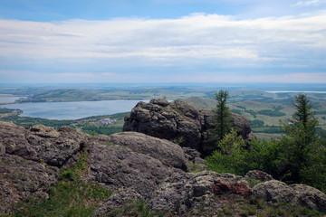 Panoramic view of Bannoe Lake from top of Kryktytau Range, South Ural, Russia