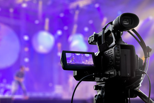 Video production covering event on stage by professional video camera