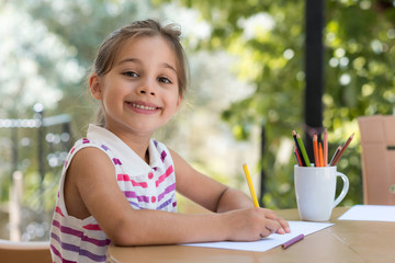 Happy Smiling Preschool Child Girl Drawing Pictures Outdoors in Garden in Summer Time