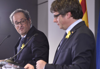Pro-independence Catalan leader Quim Torra and former Catalan leader Carles Puigdemont hold a news conference in Brussels