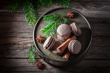 Top view of macaroons with cinnamon and chocolate for Christmas