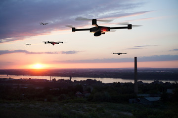 group of drones above the city