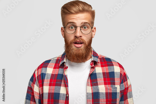 b3aca5ae57 Horizontal shot of surprised young businessman has shocked expression
