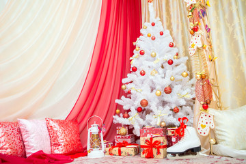 Christmas decorations. Happy New Year. Antique lantern, Christmas balls, gift boxes with ribbons. White Christmas tree with balls