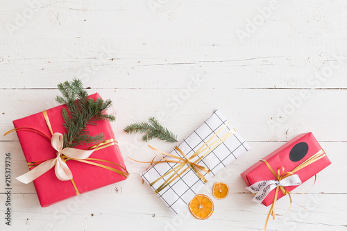 top view on nice christmas presents decorated with ribbons tree branch and orange slices on - Nice Christmas Gifts