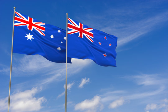 New Zealand and Australia flags over blue sky background.