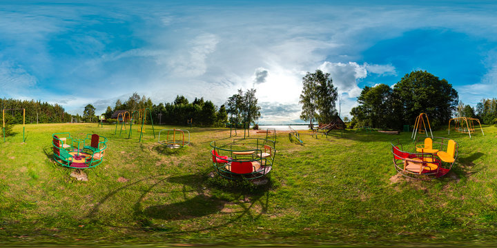 Playground with blue sky and green grass. 3D spherical panorama with 360 degree viewing angle. Ready for virtual reality in vr. Full equirectangular projection. Beautiful background.