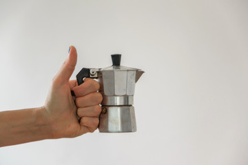 Isolated woman hand holding a moka - traditional italian coffee maker, white background and copy space