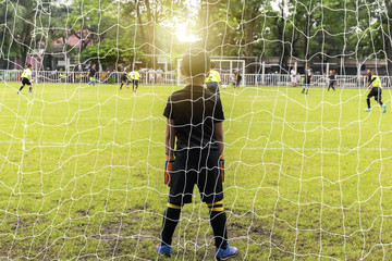 Goalkeeper standing Doing a defense against a business that needs to be protected.