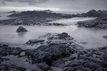 Black and white seascape at dusk