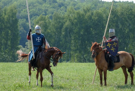 medieval knight with a spear riding a horse