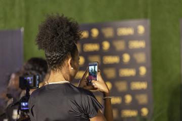 Beautiful african woman, taking photos