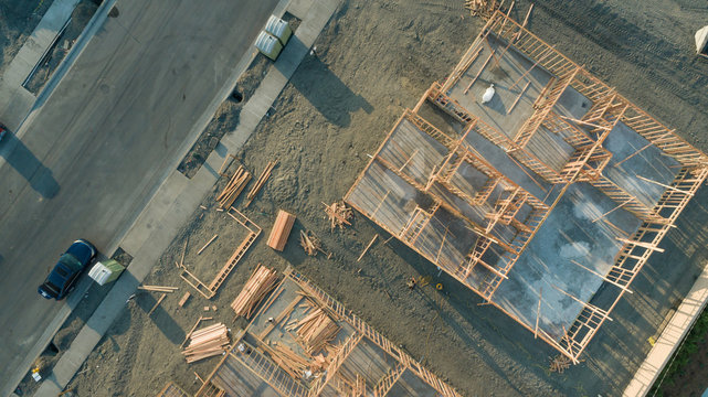 Drone Aerial View of Home Construction Site Foundations and Framing