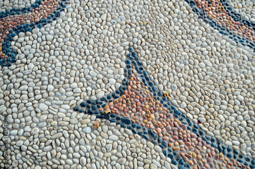 The texture of the stone wall, the road from small round and