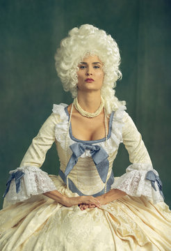 Marie Antoinette cosplay. Victorian dressed female model.
