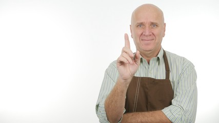 Smiling Person Wearing Apron Make Attention Sign Warning with a Hand Gestures