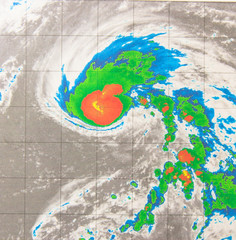 Infrared satellite imagery provides temperature data of tropical storm. Coldest cloud tops circling the center resembled a strawberry and leaf. Elements of this image furnished by NASA.