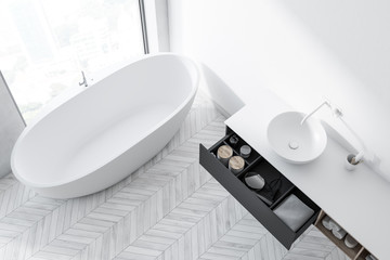 Top view of a white wood floor bathroom