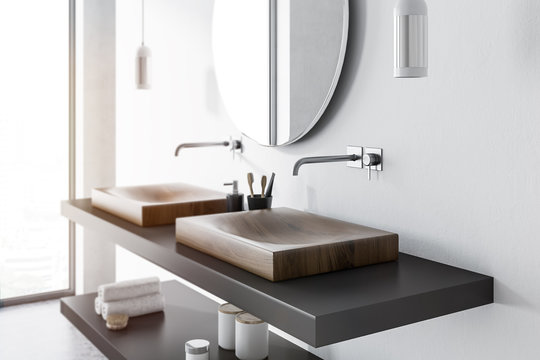 Double sink side view, concrete bathroom