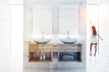 Woman in a white bathroom interior