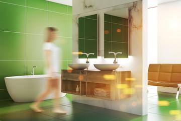 Green bathroom inteiror, double sink, woman