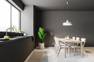 Luxury gray dining room and kitchen side view