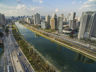 """Large cities with river or sea and buildings, aerial view of the """"Marginal Pinheiros"""" Avenue, Pinheiros River and skyline of Sao Paulo city"""