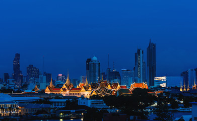 Wall Mural - Grand palace and Wat Phra Kaew surround by modern buildings, in Bangkok city Thailand