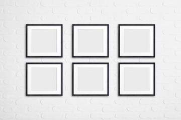 Photo frames collage on white bricks background, interior decor mockup