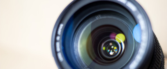 banner for website, lens digital camera, selective focus, close-up, side with reflection, bokeh, isolated on white background