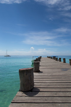 Empty wooden jetty in a lonely environment with a fantastic sea view of the Caribbean Sea
