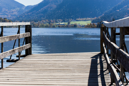 Empty wooden jetty in a mountainous landscape on a lake