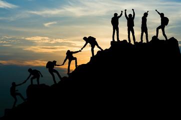 Group of people on peak mountain climbing helping team work , travel trekking success business...